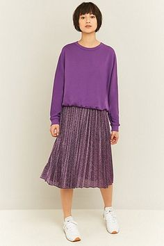 Purple with purple. Supersweet combination of purple sweater and matching pleated midi. by UrbanOutfitters