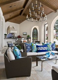 We love the bright color of these throw pillows against the otherwise neutral decor. #beachhouse #nautical