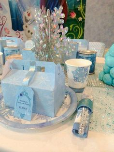 Favors and place settings at a Frozen birthday party! See more party planning ideas at CatchMyParty.com!