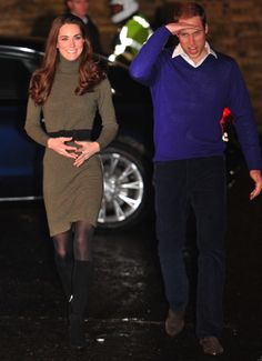 Belted turtleneck sweater dress with boots - love.  And the guy on the right is not too bad either....