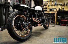 "Kott Motorcycles Rear View of Copper Wheels on ""Patina"" vintage Honda cafe racer"