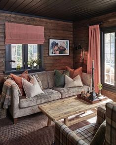 Image may contain: 1 person, sitting, living room, table and indoor Cozy Cabin, Cottage Interiors, My Living Room, Log Homes, Interior Design Living Room, Family Room, House Ideas, Home Decor, Person Sitting