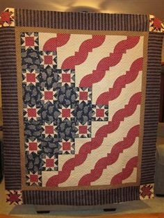 Quilts of Valor - Mark Lipinski Quilt - Quilters Club of America INSPIRATION~ Change the drunkard's path to red and white log cabins, change the blue field to something with smaller print.