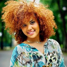 Bold, sharp, colorful curly hair.