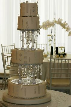 Hmmmm..I could do these tier separators pretty easily.  Great look for just about any wedding cake.