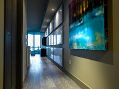 A mixed-media painting by Miami- and Atlanta-based artist Anthony Liggins pulls in the apartment's color palette and represents Miami in a unique way.