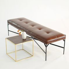 brown faux leather bench with black powder coated metal frame                                                                                   custom made in our Taylor Creative studio