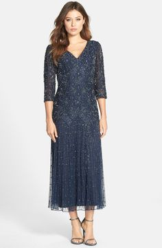 Free shipping and returns on Pisarro Nights Beaded Mesh Drop Waist Dress (Regular & Petite) at Nordstrom.com. Ornate floral beadwork covers the long mesh overlay of a double V-neck gown fashioned with a zigzag design at the dropped waistline.