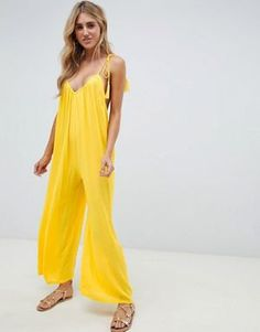 fcf00f5659 ASOS DESIGN crinkle low back beach jumpsuit with tassel ties in yellow