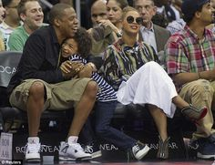 Family outing: Swapping her sandals for a pair of Christian Louboutin heels, the singer later joined her husband Jay-Z and nephew Daniel at the New Jersey Nets V Miami Heat game in Newark