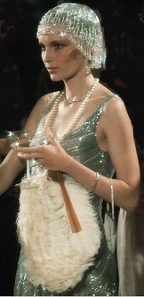 """Mia Farrow, playing Daisy Buchanan in the """"The Great Gatsby"""" (1974).  Director: Jack Clayton.  Screenplay: Francis Ford Coppola (screenplay), based on F. Scott Fitzgerald's classic novel. Also starring: Robert Redford (as Jay Gatsby), Bruce Dern (as Tom Buchanan), and Sam Waterston (as Nick Carraway)."""