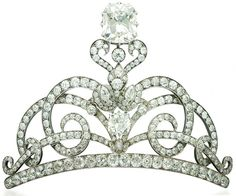 Christie's sale 1385 Geneva Magnificent Jewels, 16 November 2011: AN ANTIQUE DIAMOND TIARA Designed as intertwined scrolling lines set with old-cut diamonds, on a diamond-set line base, centering upon a cushion-shaped diamond under a foliate motif, surmounted by a cushion-shaped diamond, weighing 14.29 carats, to the detachable gold headband, covered with black velvet, mounted in silver and gold, circa 1900, in brown leather case, formerly the property of Dame Miriam Rothschild DBE, FRS.