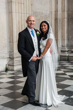A beautiful black bride, photographed on her chic London wedding day, wearing a @Belle & Bunty gown.  Photography by http://steveshipmanphotography.com/
