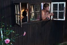 A woman looks out the window of her one-room hut at a squatter camp for poor white South Africans at Coronation Park in Krugersdorp, South Africa on March (REUTERS/Finbarr O'Reilly) Picture Editor, Looking Out The Window, Teaching History, Big Picture, The Guardian, Looking For Women, South Africa, Pictures, Image