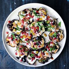 One of my favorite things to eat; caramelized eggplant slices topped with a tangy lemon yogurt, pomegranate molasses, toasted almonds, pomegranate seeds, herbs, and spices. Always perfect.