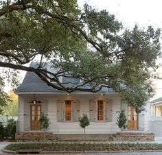 New Orleans Creole cottage renovation in the Irish Channel neighborhood. Love the doors and the shutter color.