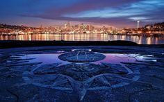 I've stood here on the top of of the hill in gasworks park overlooking the city many times, [the beautiful mosaic compass]