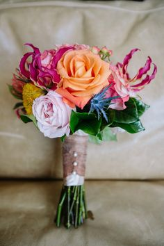 Aqua & Orange Beach Wedding flowers that are so beautiful that I can see Emily loving.