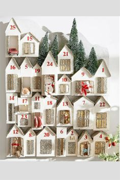 Love how this advent calendar is lit from within so that every house glows. Makes it look so friendly and homey. #adventcalendar #christmas #affiliate