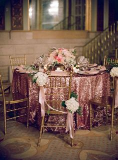 Sequins for Winter: Table Linen laden with sequins & chairs with swags of Hydrangeas create warm & rich textures / http://www.thewhiteconnection.com/blog/post/sequins-winter-wedding#
