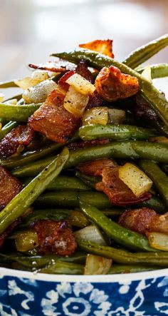 Sweet and Sour Green Beans with lots of bacon and onions. - Green beans cooked with lots of bacon and onion and coated in a sweet, salty, and sour sauce make one of the best side dishes ever. The kind of side dish where you don't even care if there is a main dish.