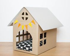 'Scandinavian style' cardboard House for small #dog or cat. Colours (flags and roof) and possibility to add elements (CAT, #dog, fireplace... ears). Product is hand in an apartment Rochelais, tested and approved by Bonnie the Cat. The House is 45cm long, 30cm wide and the Interior maximum height is 45cm. Do not hesitate to contact me for more information and to discuss together the customization. Cushion not included. For deliveries outside France, please contact me. #cathouseforoutside