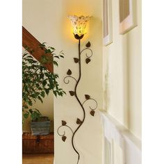 Wall lighting=find tulip or petal shape sconce and paint the vine/leaves/tendrils.