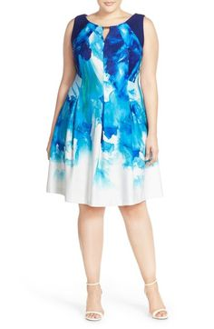 Free shipping and returns on Gabby Skye Keyhole Detail Print Scuba Fit & Flare Dress (Plus Size) at Nordstrom.com. Vibrant watercolor brushstrokes put an artful spin on a stretchy, scuba-knit dress with a cool metallic keyhole neck and angular seaming through the fitted bodice.