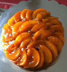 Peach Upside Down Cake A delicious vanilla sponge cake soaked with vanilla Dark rum syrup, topped with slice peaches, glaze with peach preserves. Peach Upside Down Cake, Banana Pie, Peach Preserves, Vanilla Sponge Cake, Peaches, Syrup, Bourbon, Glaze, Sausage