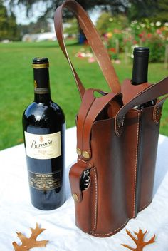 Leather double wine bottle tote with corkscrew pocket.  Etsy sale item (sold).