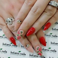 Red and floral stiletto nails by Botanic Nails.
