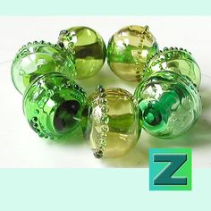 Green Ice - 7 hollow glimmery beads - lampwork by Sarah Moran. $120.00, via Etsy.