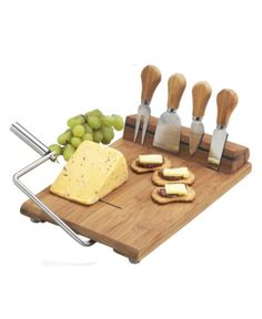 The Stilton cheese board set with wire cheese slicer and magnetic tool strip. Includes: Stainless steel serving tools, Cheese Knives Cheese spreaders Cheese fork Extra cutting wire The magnetic strip neatly holds tools when not in use. Stilton Cheese, Cheese Board Set, Picnic At Ascot, Cheese Spreaders, Cheese Party, Wine Cheese, Cheese Platters, A Table, Pub Tables