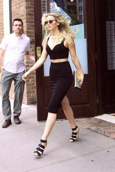 Whoa, mama! Lawrence shows off her killer abs in a Michael Michael Kors Fall 2015 crop top and high-waisted skirt, finishing off the look with cool cage heels.   - MarieClaire.com
