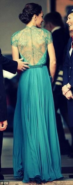 Sheer beauty: The Duchess of Cambridge looks stunning in daring teal dress gown…