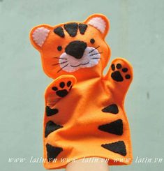 Tiger Felt Hand Puppet - free ship Made from felt, this hand puppet is tall. Each piece is hand cut and sewn together one tiny stitch at a time. No glue or beads are used. Felt Puppets, Puppets For Kids, Felt Finger Puppets, Bird Puppet, Animal Hand Puppets, Tiger Crafts, Puppet Patterns, Puppet Crafts, Bear Felt