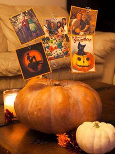Use a pumpkin to display photos from Halloweens past. http://www.diynetwork.com/how-to/make-and-decorate/decorating/2015-pictures/unique-pumpkin-decorating-ideas-for-2015-