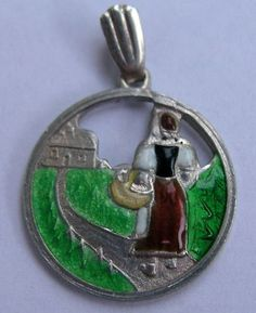 German silver and enamel charm
