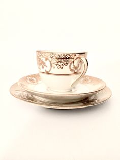 A personal favorite from my Etsy shop https://www.etsy.com/listing/479861606/vintage-noritake-ivory-gold-tea-cup