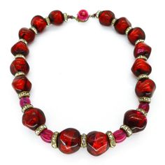 Vintage 1950s French Cranberry Red Foil Glass Bead Necklace A stunning French necklace featuring irregular shaped glass beads embedded with foil. The beads are a lovely deep red shade with hints of pink. The necklace is finished with a beautiful foil push clasp marked 'Made in France' on its base. | Clarice Jewellery