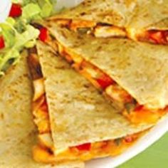 Zesty chicken and cooked peppers are a tasty delight when mixed with cheese and stuffed in a tortilla to create chicken quesadillas.