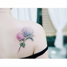Hydrangea tattoos on the right shoulder blade.
