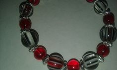 Unique glass beaded stretch bracelet in red and silver. Wow! by tonispretties on Etsy