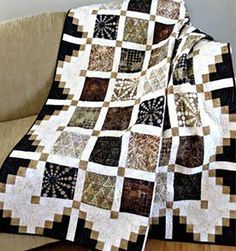"""This quilt is super easy and fast to make. Great for beginner on up! It would make a wonderful scrap quilt. You can also personalize the quilt by using novelty fabrics in the 6"""" center blocks. The bor"""