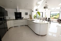 Curved kitchen design: Open plan kitchen extension with a white and grey gloss lacquer curved peninsular. #kitchen #interiors #design #inspiration #ideas