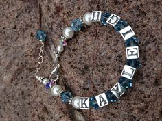 Bracelets are all handmade with attention to detail. Using only the finest quality of materials, Solid Sterling Silver, genuine Swarovski Crystal and Bali Silver. Each bracelet is strung on professional accuflex beading wire to ensure strength and durability.    These darling bracelets are customized to your liking.  Sterling silver alphabet beads and sparkling Swarovski crystals in the color of your choice.     Prices starting at $35