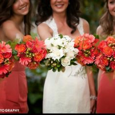 Coral wedding flowers for brides maids and white for the bride