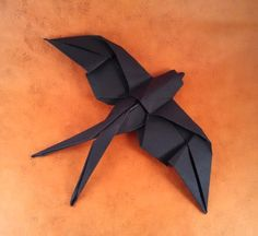 Origami Swallow by Mindaugas Cesnavicius Wet folded from a square of cardstock by Gilad Aharoni on giladorigami.com