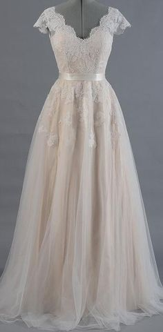 BB1352. This beautiful lace boho/ vintage style wedding gown vith v neck front and back, capped sleeves and pretty lace detail on A line skirt in store now in Albany village. See more on http://bridalandball.co.nz/wedding-gowns/