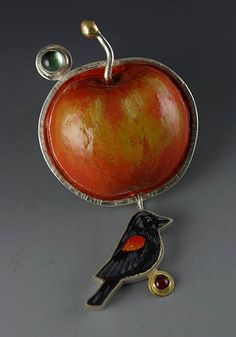 "Sarah J.G. Wauzynski: Brooch in sterling silver with egg tempera on gesso. 3"" long."